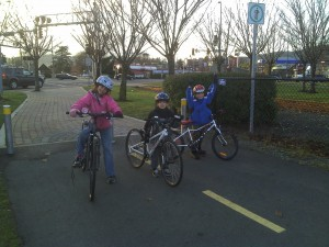 Kids posing triumphantly with their bikes